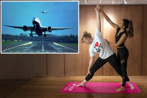 Teacher Shona Vertue takes a passenger through the motions of yoga at Gatwick Airpot's 'floga' lounge.